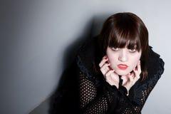 Goth Girl Cowering in Corner Stock Photo