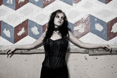 Goth girl leaning on wall royalty free stock photo