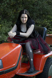 Goth girl on a tractor Stock Image