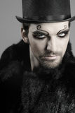 Goth male. Close-up portrait of young male goth model in face makeup Stock Photography