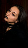 Goth style portrait of a female in black clothing and make up Royalty Free Stock Images