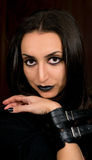 Goth style portrait of a female in black clothing, make up and detailed hand Stock Photography