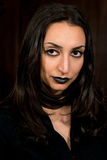 Goth style portrait of a girl in black clothing and make up Stock Image