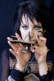 Goth Woman with Aladdin's Lamp. A young goth woman holds Aladdin's lamp Stock Photo