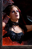Goth woman in broken window Royalty Free Stock Images