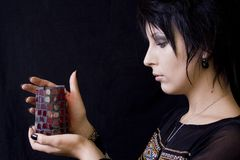 Goth Woman with Candle. A young goth woman holds a lighted candle used in a pagan ritual or ceremony Royalty Free Stock Photos
