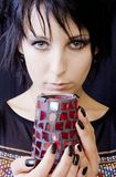 Goth Woman with Candle. A young goth woman, perhaps a priestess, holds a lighted candle used in pagan rituals and ceremonies Royalty Free Stock Images