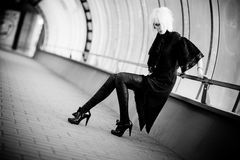 Goth woman in industrial tunnel Stock Photos