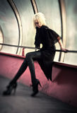 Goth woman in industrial tunnel stock photography