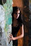 Goth woman looking round door Stock Photos