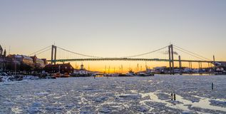 Gothenburg - Beautiful sunset at frozen Gota river with Hisingsleden Bridge in the harbor district during winter Stock Images