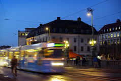 Gothenburg at night. Some trams and people in motion stock images