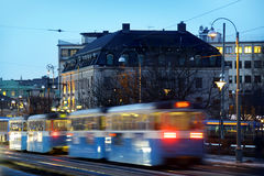 Gothenburg at night. Some trams and people in motion stock photography