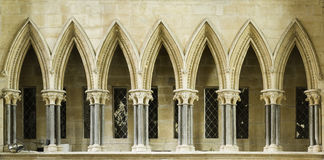 Gothic. Pointed arches along a walkway above the entrance to the chapter house at Lincoln cathedral, England Royalty Free Stock Images