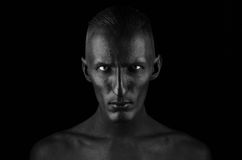 Free Gothic And Halloween Theme: A Man With Black Skin Is Isolated On A Black Background In The Studio, The Black Death Body Art Stock Image - 61057531