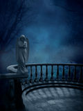 Gothic Angels Watching. A background with foggy setting as an angel statue looks on Royalty Free Stock Images
