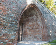 Gothic arch. Ancient gothic arch made of red bricks Stock Photos