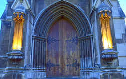 Gothic arched wooden and stone cathedral entrance Stock Photo