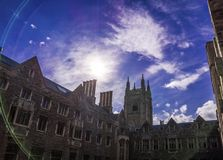 Toronto, Canada - 20 10 2018: Hart House building in front of bright blue sky with shiny sun and white cirrus clouds. Hart House is University of Toronto stock photo