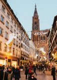 Gothic architecture Christmas Market Strasbourg Notre-Dame cathe. STRASBOURG, FRANCE - DEC 8, 2015: Traditional Christmas Market atmosphere and light decorations Royalty Free Stock Photography