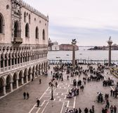 Italy, Venice, St. Marks Square, in winter, people in winter clothing ,looking to Grand Canal with Doge Palace on left royalty free stock photo