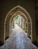 Gothic archway in medieval path in Souzay Champigny France. A unique bicycle path and walking trail in the small village of Souzay Champigny France. Gothic stock image