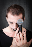 Gothic artist with mic Stock Images