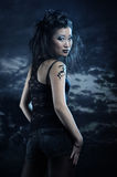 Gothic asian girl. On dark background Royalty Free Stock Photo