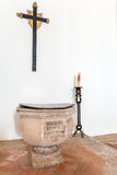 Gothic Baptismal Font with writings in Santa Clara Church. Royalty Free Stock Photography