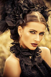 Gothic belle. Close-up portrait of a beautiful gothic woman. Make-up, hairstyle.  Medieval history, old times. Fashion. Gothic style Royalty Free Stock Images