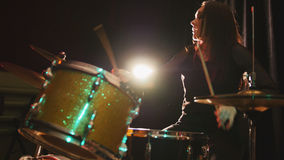 Gothic black hair girl percussion drummer perform music break down - teen rock music. Telephoto Stock Photography