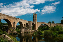 Gothic bridge in Besalu Stock Images