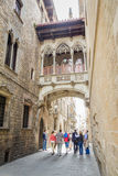 Gothic bridge in Carrer del Bisbe street, in Barcelona, Spain Royalty Free Stock Images