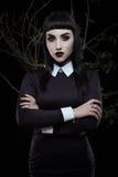 Gothic brunette girl stock photos