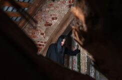 Gothic Brunette Woman Standing Near The Window In Attic Royalty Free Stock Photography