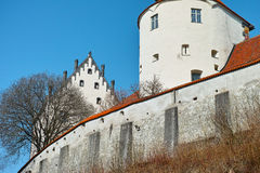 Gothic castle white walls. Detail of a Gothic castle in Germany by a blue sky in winter Stock Images