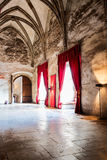 Gothic castle interior. Interior detail of an Gothic-Renaissance style castle with red drapes and modern lights Stock Photos