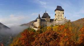Gothic Castle Karlstejn. Beautiful Karlstejn Castle in the autumn woods near Prague Royalty Free Stock Photo