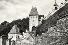 Gothic castle Karlstejn in Czech republic, walls and turrets, co Stock Photos