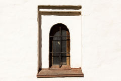 Gothic castle. The old prison wall window with iron bars Stock Images