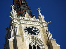 Gothic cathedral. Tower with clock of the neogothic cathedral in Novi Sad, Serbia Stock Photos