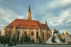 Gothic Cathedral church in the center of Cluj-Napoca. In Transylvania Region of Romania with the Unirii Square and Matei Corvin statue Royalty Free Stock Images