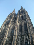 Gothic Cathedral of Cologne. A view looking up at the two main steeples of the massive Cathedral of Cologne, Germany Stock Image