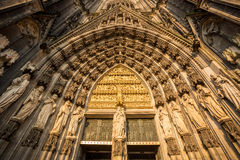 Gothic cathedral in Koln, Germany. Sculptures around main door to gothic cathedral in Koln, Germany, Europe Stock Photos