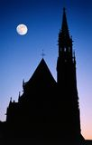 Gothic cathedral moon night. Gothic cathedral silhouette at night with moon royalty free stock image