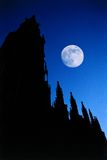 Gothic cathedral moon night. Gothic cathedral silhouette at night with moon royalty free stock photography