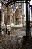 Gothic Cathedral Side Entrance in Chartres France. Gothic Cathedral of Our Lady North transept facade carved stone portals viewed through the parish garden Stock Photos