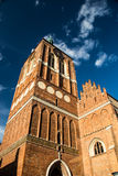 Gothic cathedral St. John Church in Gdansk. Gothic renovated cathedral St. John Church in Gdansk, Poland. Facade with white clouds on blue sky photography Stock Image