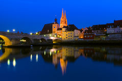 The Gothic cathedral of St. Peter's and the Stone Bridge of Regensburg, Germany Stock Images