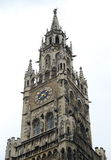 Gothic chapel tower with clock. At Munich Royalty Free Stock Photography